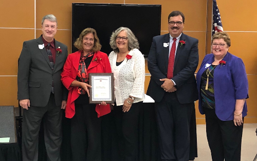 Indian Hill Board of Education President honored for outstanding service