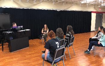 Sarah Mossman with students